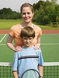 Mother and son on tennis court
