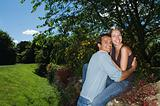 Couple hugging on a stone wall