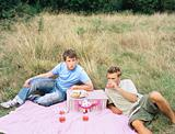 Two men having a picnic