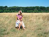 Woman sitting on chair in a field
