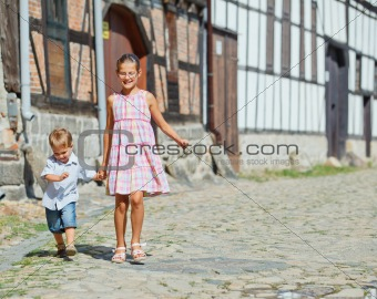 Cute brother and sister in city