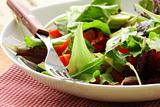 mix salad (arugula, iceberg, red beet) in a bowl on the table