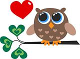 a cute little brown owl with a heart