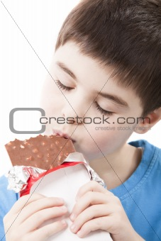 Boy with chocolate in the hands