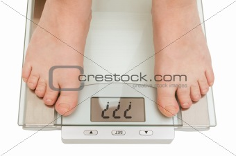 Female feet on scales