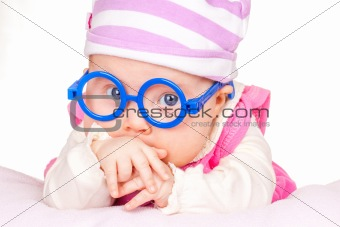 portrait of funny baby with glasses