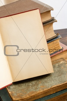 Blank Open Page With Antique Books