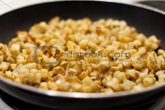Potatoes Frying in a Pan
