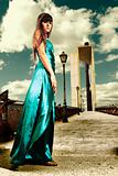 Young woman fashion outdoor cross processing dress urban scene