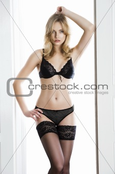 lingerie sensual blond woman, she looks in to the lens