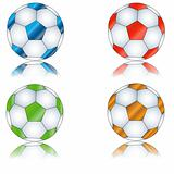 Four multi-colored footballs