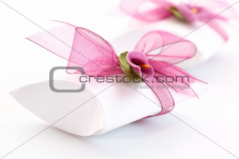 Small gift box decorated with ribbon