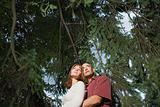 Couple under tree branches