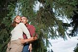 Couple hugging in a forest