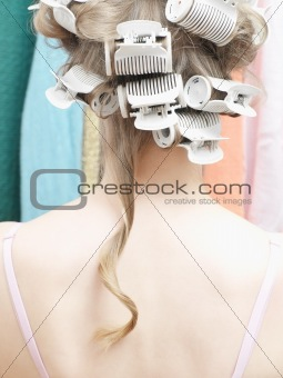 Woman with curlers in her hair