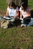 Girls revising outdoors