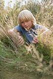 Boy in overgrown grass