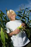 Boy holding fresh corn on the cob