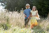 Two children in an overgrown field