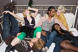 Young people on bed at party