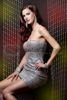 brunette and silver dress
