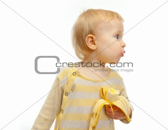 Baby with banana looking on side isolated on white