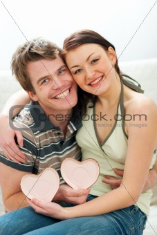 Portrait of couple with Valentines hearts