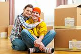 Portrait of moving to new house young couple among boxes