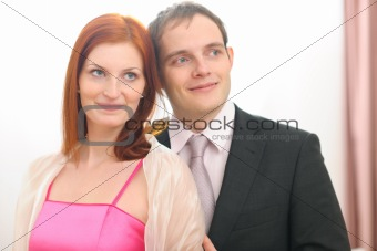 Portraits of formally dressed couple