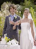 Bride and groom with champagne glasses