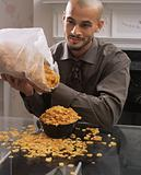 Man spilling cornflakes