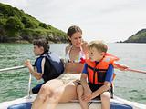 Mother and sons on boat