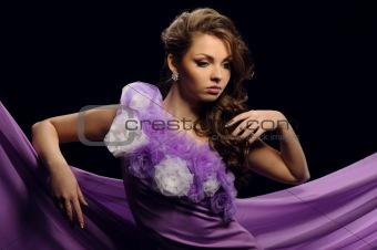 beautiful girl in a purple dress
