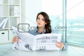 Business lady with newspaper