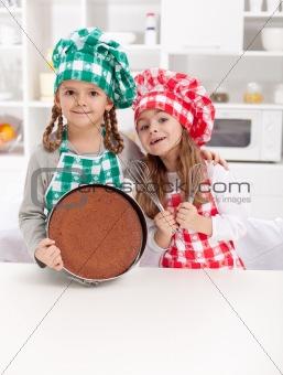 Little chefs baking a cake