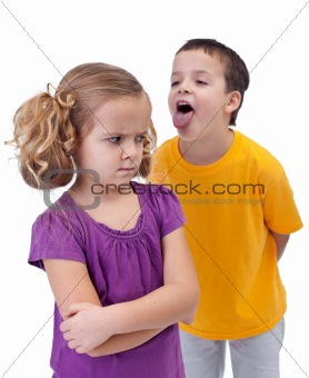 Upset little girl bullied by older boy
