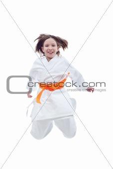 Jumping karate girl in kimono