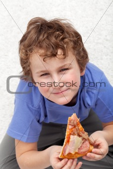Boy with a slice of pizza
