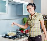 Portrait of a girl cooking