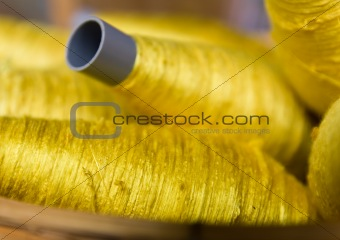 Sewing threads golden color