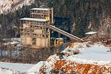 Stone quarry with silos, conveyor belts in winter