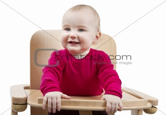 young child sitting in high chair