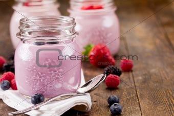 Small jars with homemade yogurt with berries