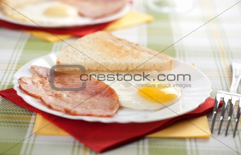 Breakfast. Eggs, toasts and bacon