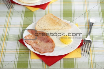 breakfast with eggs, bacon and toast