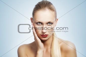 beauty woman over white. She has the hand near the face