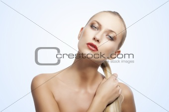 beauty woman over white. She takes her tail of hair
