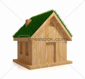 Wooden house with a green grass on a roof.