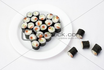 Sushi on a plate in the shape of a heart