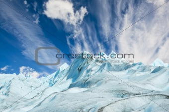 Climbers walk up on glacier in Patagonia.